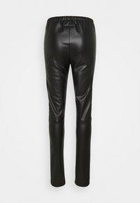 MM6 Maison Margiela - PANTS - Trousers - black - 1