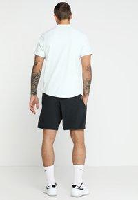 Mizuno - FLEX SHORT - Sports shorts - black - 2