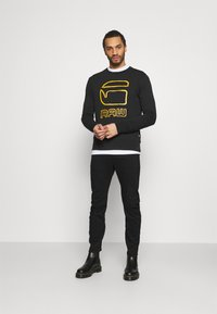 G-Star - ARC SLIM - Slim fit jeans - nero black stretch denim - pitch black - 1