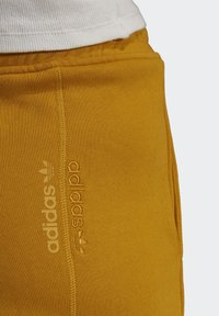 adidas Originals - Tracksuit bottoms - legacy gold - 7
