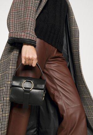 THE ULTRA MINI BAG - Handbag - black