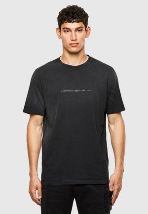 JUBIND SLITS - Print T-shirt - black
