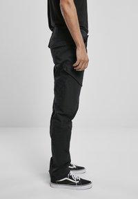Brandit - ACCESSOIRES ADVEN  - Cargo trousers - black - 4