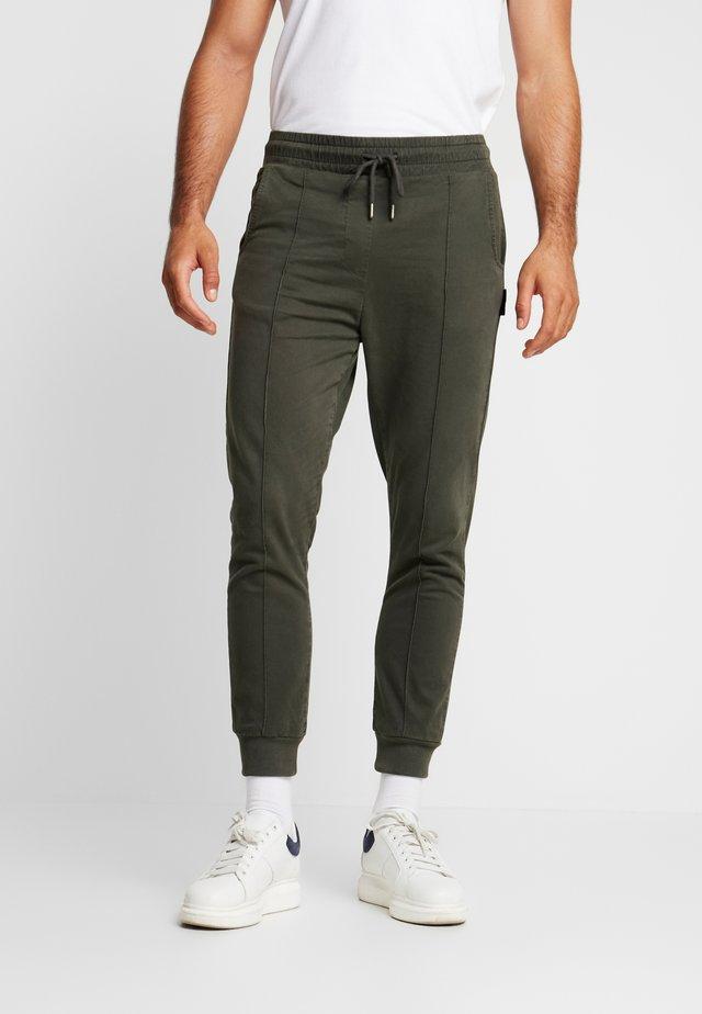 BELUNIK - Jeans Tapered Fit - khaki