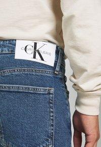 Calvin Klein Jeans - CKJ 026 SLIM - Jeans slim fit - mid blue - 3