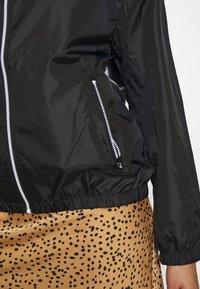 Calvin Klein Jeans Plus - PLUS LARGE CK HOODED ZIP THROUGH - Training jacket - black - 5