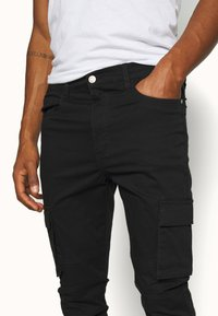 RETHINK Status - PANTS - Cargo trousers - black - 4