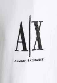 Armani Exchange - JOGGER - Tracksuit bottoms - white - 2