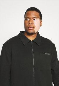 Calvin Klein - JACKET - Zip-up sweatshirt - black - 3
