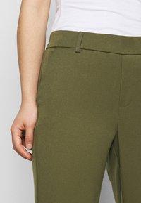 Vero Moda Petite - VMMAYA SOLID PANT - Trousers - ivy green - 5