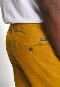 Lindbergh - CORD TROUSERS - Trousers - dark yellow - 5