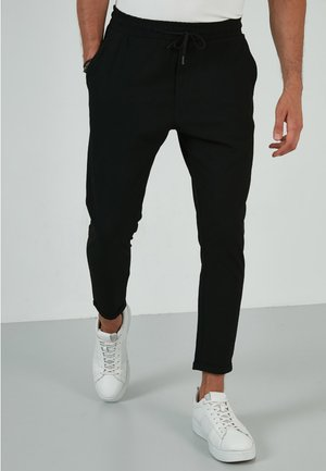 DRAWSTRING - Trousers - black