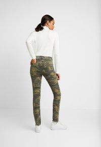 NGHTBRD - MILITARY MOONCHILD - Slim fit jeans - coloured denim/khaki - 3