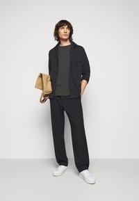 Filippa K - TEE - Basic T-shirt - dark spruce - 1