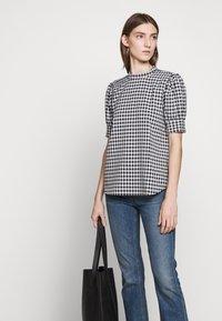 Bruuns Bazaar - SEER ADELAIA BLOUSE - Blouse - black/white - 4