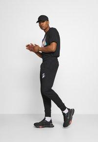 Nike Sportswear - PANT - Spodnie treningowe - black - 1
