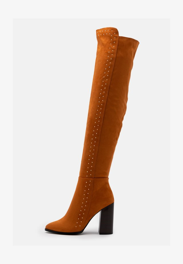 High heeled boots - cognac