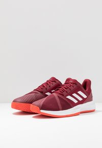 adidas Performance - COURTJAM BOUNCE CLAY - Clay court tennis shoes - collegiate burgundy/footwear white/active orange