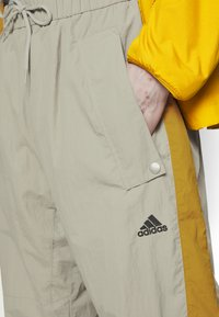 adidas Performance - MUST HAVES ENHANCED SPORTS  - Tracksuit bottoms - feather grey - 4
