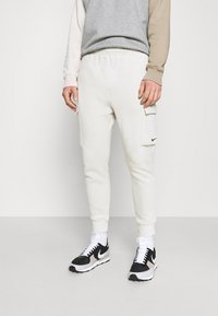 Nike Sportswear - PANT  - Träningsbyxor - light bone - 0