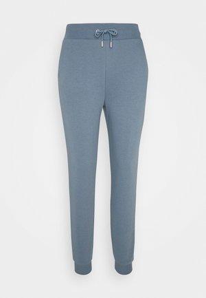 FIT - Tracksuit bottoms - blue