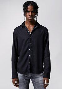 Tigha - SENYO - Shirt - black - 0