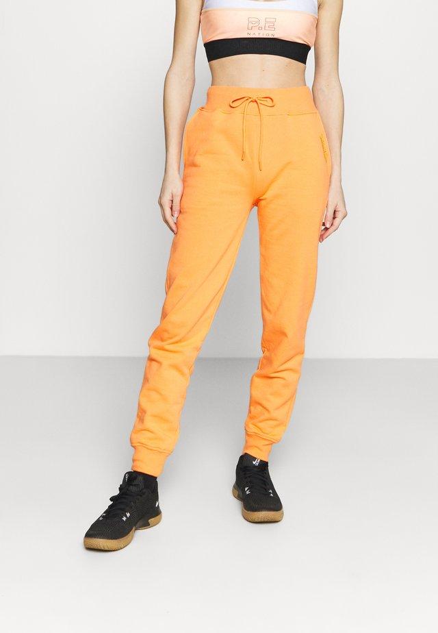 WOMENS ESSENTIAL - Trainingsbroek - orange