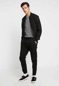 Solid - TRUC CUFF - Trousers - black - 1