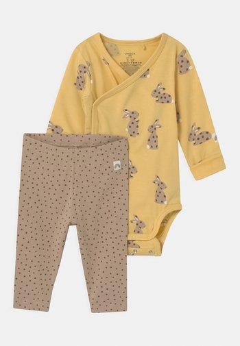RABBIT SET UNISEX - Leggings - Trousers - light dusty yellow