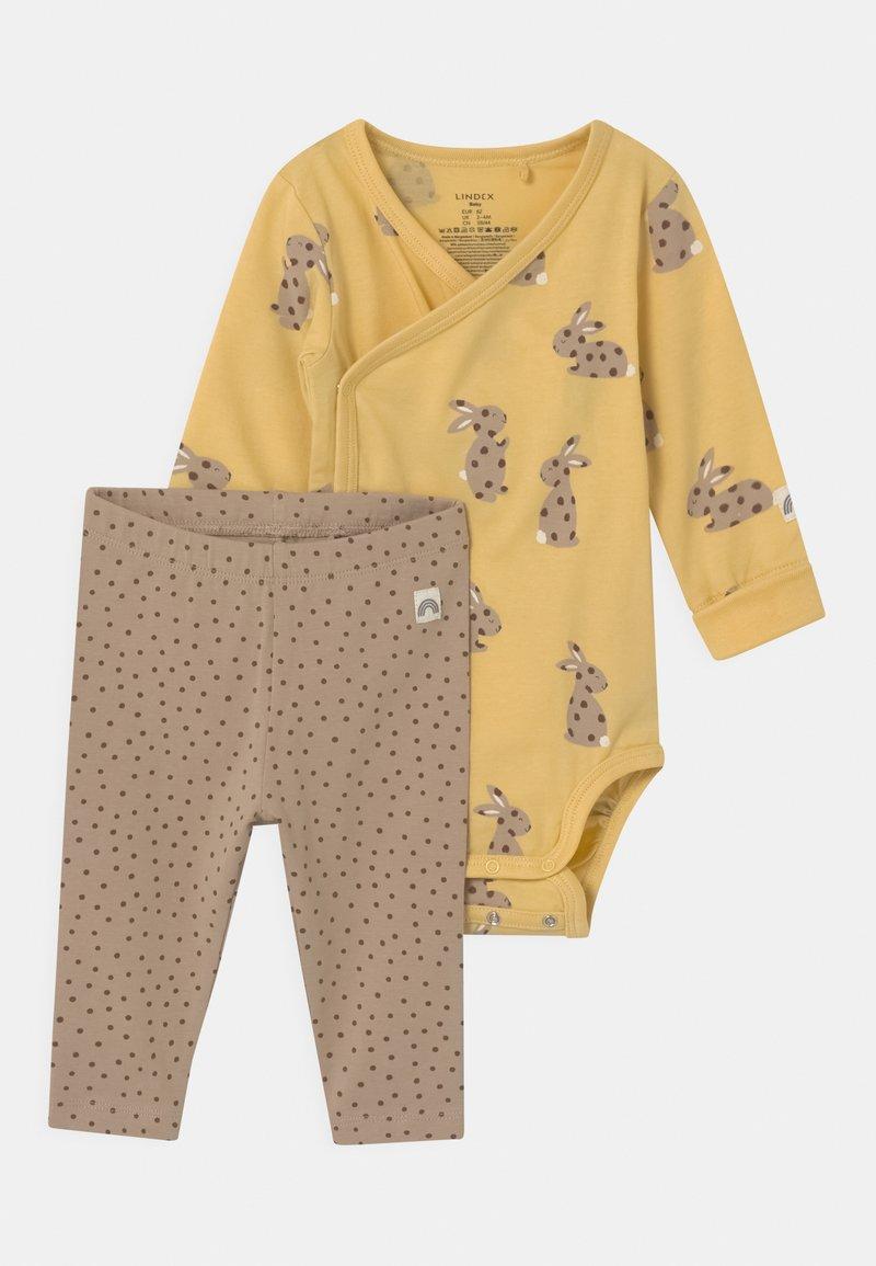 Lindex - RABBIT SET UNISEX - Leggings - Trousers - light dusty yellow