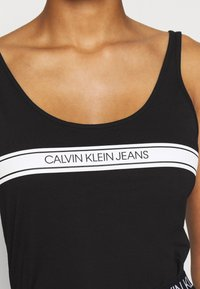 Calvin Klein Jeans - STRIPE LOGO SCOOP NECK TANK - Top - black