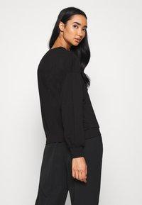 JDY - FAYA L/S FRILL - Sweatshirt - black - 2