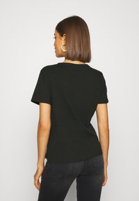 Tommy Jeans - SLIM VNECK - T-shirts - black - 2