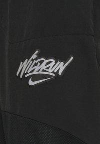Nike Performance - 7/8 PANT - Træningsbukser - black - 2
