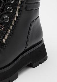 3.1 Phillip Lim - KATE LUG SOLE DOUBLE ZIP BOOT - Kotníkové boty na platformě - black - 6