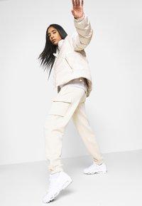 Nike Sportswear - ICON CLASH - Winter jacket - oatmeal/black - 3