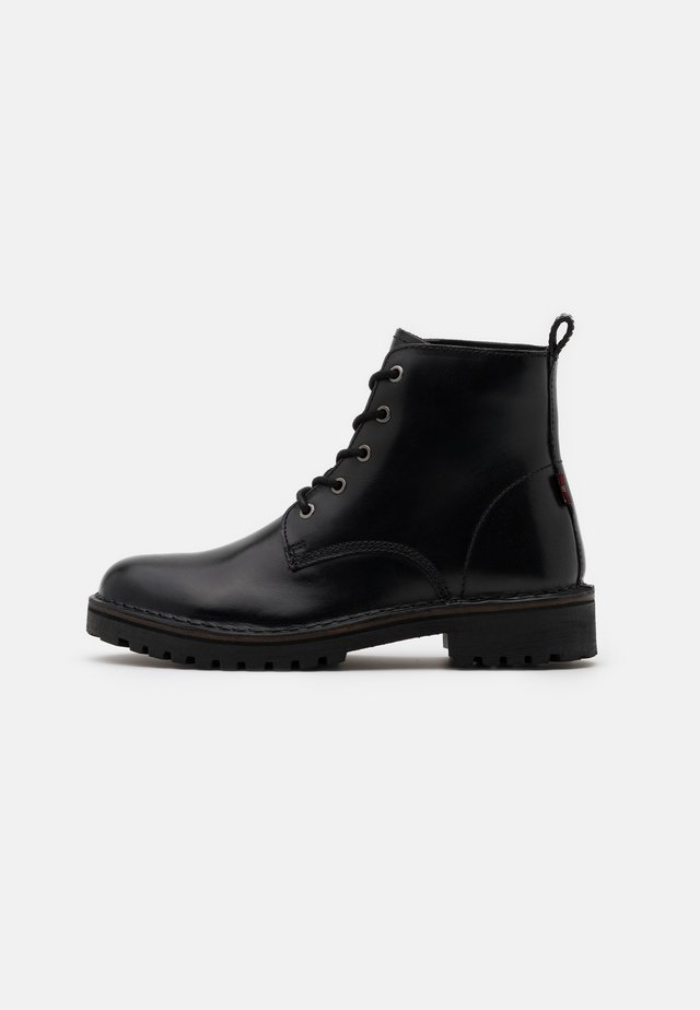 TRACKY - Lace-up ankle boots - regular black