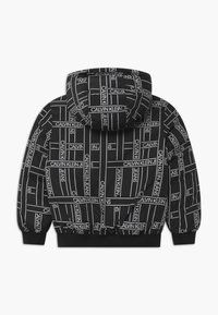 Calvin Klein Jeans - REVERSIBLE LOGO TAPE  - Vinterjakker - black - 1