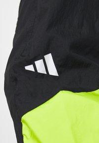 adidas Performance - URBAN PANT - Jogginghose - black/neon green - 5