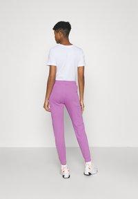 Nike Sportswear - AIR PANT - Tracksuit bottoms - violet shock - 2