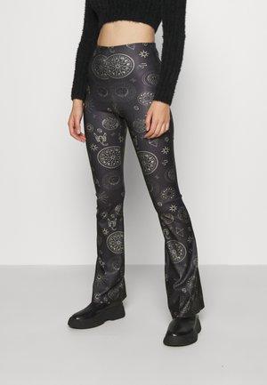 ASTROLOGY FLARE - Leggings - Trousers - black