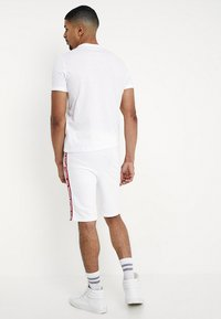 Alpha Industries - TAPE JOGGER - Tracksuit bottoms - white - 2