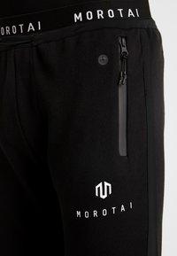 MOROTAI - Verryttelyhousut - black - 4