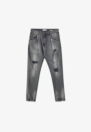 Zúžené džíny - grey