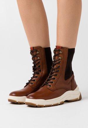MAIA - Platform ankle boots - cognac