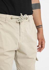 Urban Classics - JOGGING PANT - Cargo trousers - sand - 3