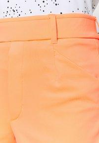 Nike Golf - DRY ACE - Sportovní kraťasy - bright mango - 4