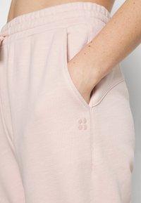 Sweaty Betty - ESSENTIALS - Tracksuit bottoms - antique pink - 3