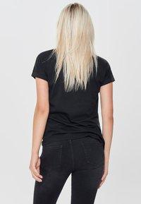 JDY - JDYLOUISA LIFEFOLD UP TOP - T-shirts - black - 2