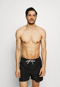 Jack & Jones - JJIARUBA SWIMSHORTS ZIP - Swimming shorts - black - 1